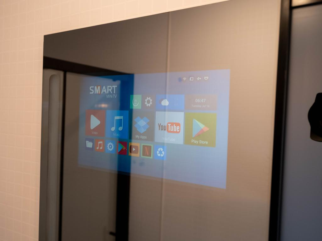 The mirror lets you watch YouTube or scroll through the news while you get ready.
