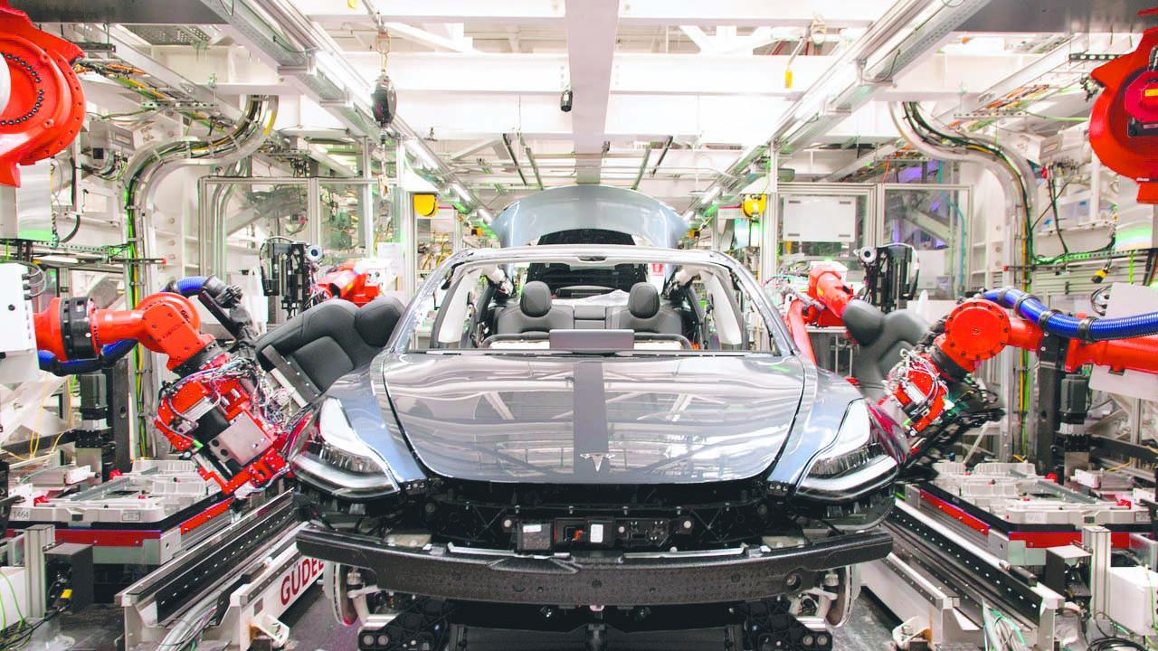 Robots on the assembly line for Tesla's Model 3 at the Fremont facility. Picture: Brian Molyneaux / WSJ