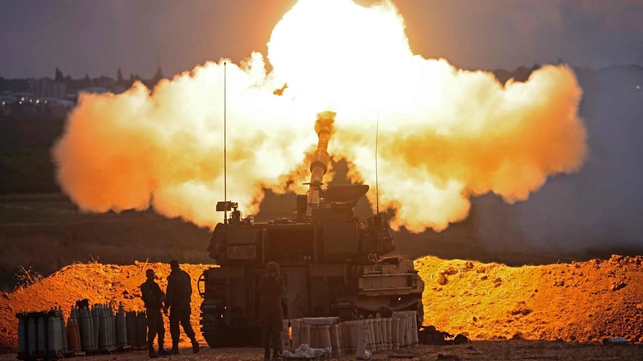 Israeli soldiers fire a 155mm self-propelled howitzer towards the Gaza Strip from their position along the border with the Palestinian enclave, on May 17, 2021. Picture: EMMANUEL DUNAND / AFP