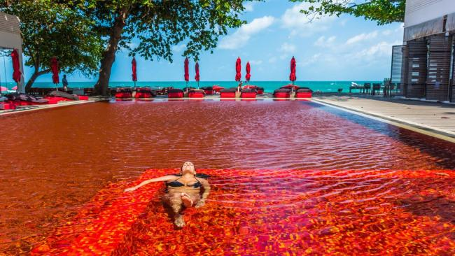 2/20 The Library, Koh Samui, Thailand Don't be fooled; the Library's crimson-red pool in Koh Samui may look like you are swimming in a pool of blood, but it's actually just the effect of a mosaic of orange, yellow and deep red tiles. In contrast, behind the pool lies the white sandy shores of Chaweng Beach's azure blue waters. It's a feast for the eyes and demands to be photographed.