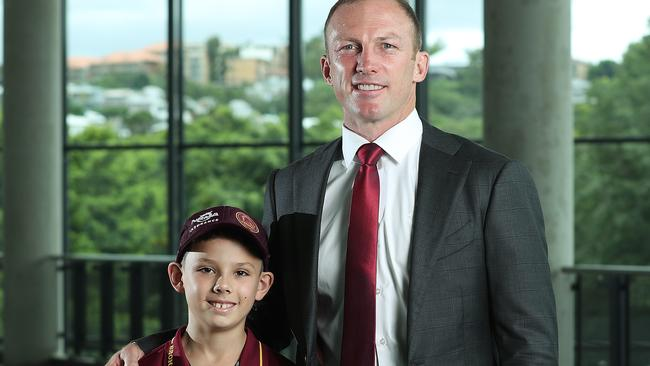 Nickolia Wolpers, 9 of Wavell Heights with his hero Darren Lockyer, at yesterday's Courier-Mail-Fox League NRL Queensland season launch at Suncorp Stadium. Picture: Liam Kidston