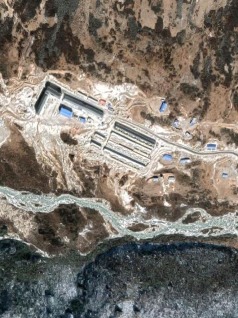 Construction of the village beside a river wholly within Bhutan. Picture: Google Maps.