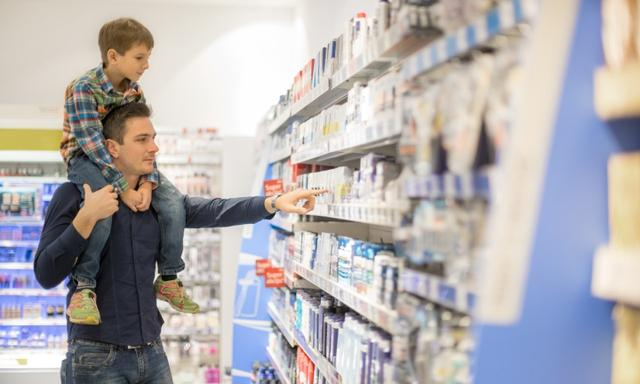 Father shopping with son for beauty products