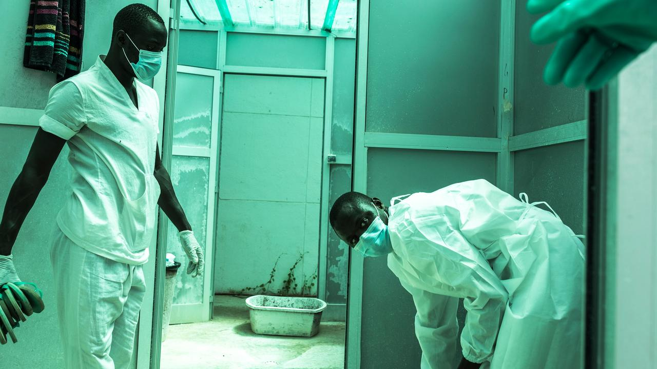 Hygienists are seen inside a decontamination area in a COVID-19 coronavirus treatment centre in Dakar. Picture: AFP