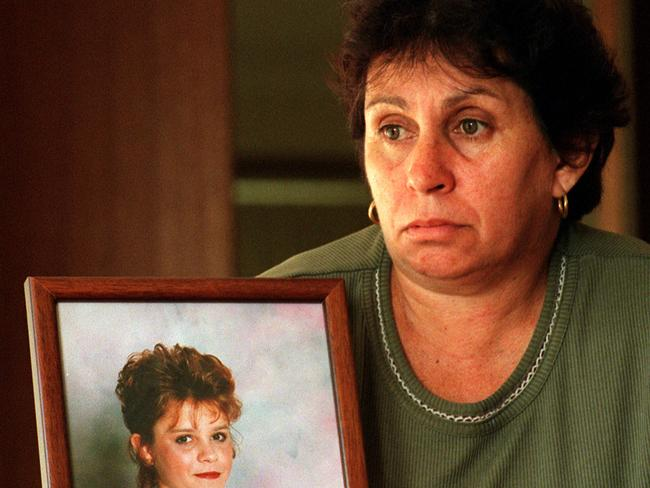 'She was my best mate', Loraine Bright, pictured holding a photograph of her murdered daughter, says of Michelle.
