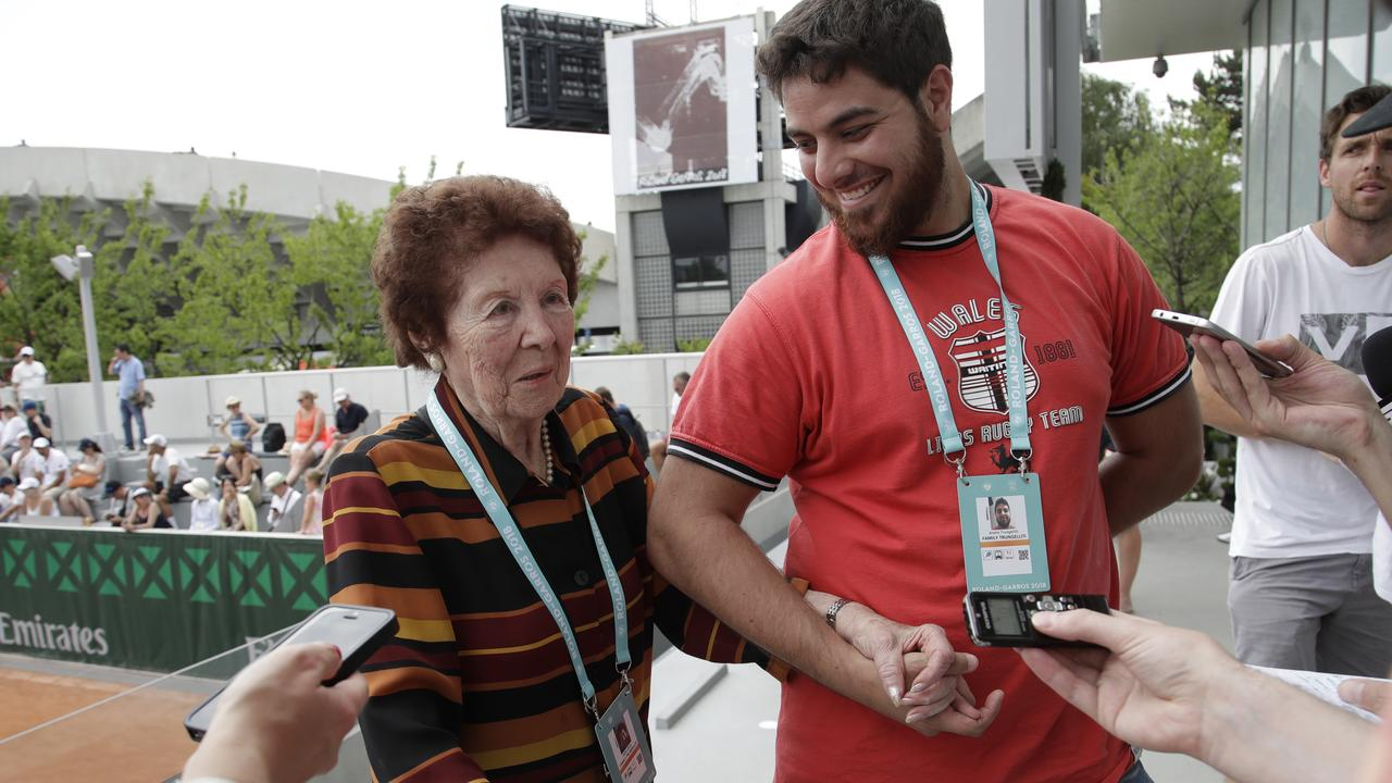 Argentina's Marco Trungelliti's grandmother Dafne Botta and his brother Andre answer reporters after he defeated Bernard Tomic.