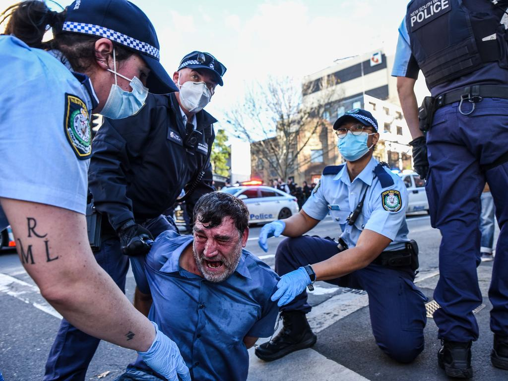 Protesters were arrested by the police during the rally in central Sydney. Picture: NCA NewsWire/Flavio Brancaleone