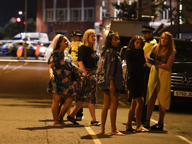 Women stand at a police cordon set up in London following a terrorist attack on London Bridge. Picture: AFP