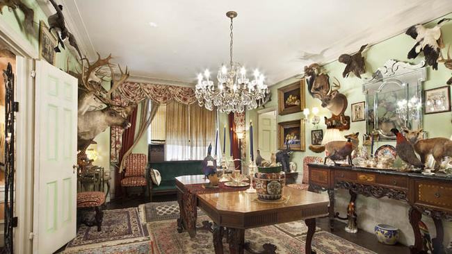 Animals and a chandelier in the dining room. Pictures: Halstead Property.