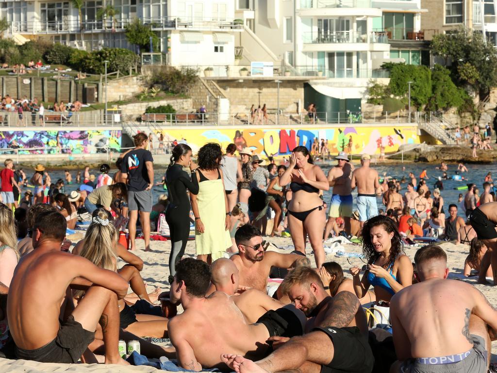 Beachgoers are seen at Bondi Beach despite the threat of coronavirus (COVID-19) in Sydney, Friday. Picture: John Fotiadis