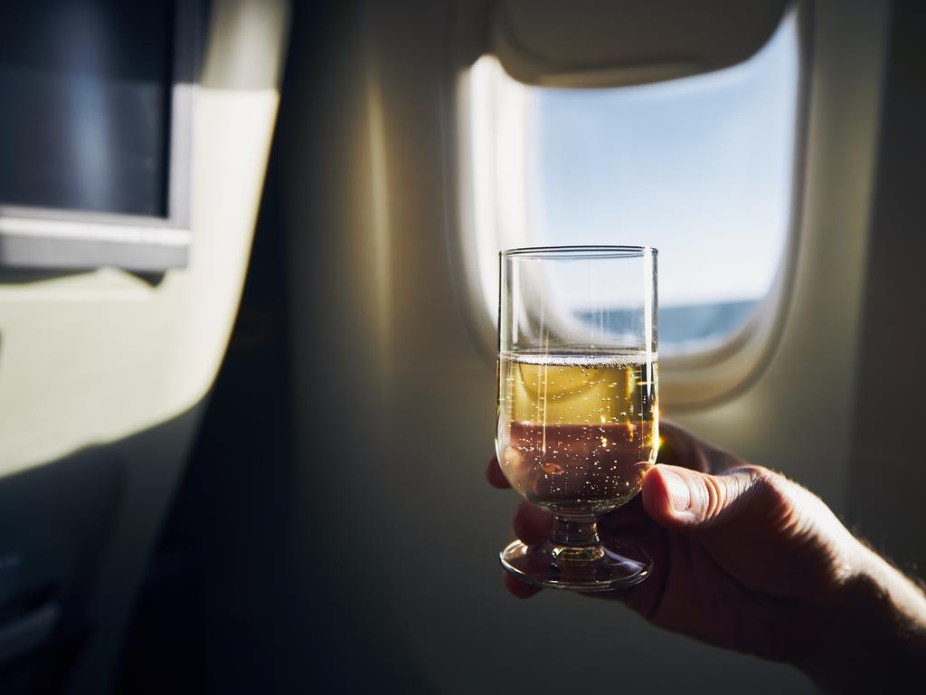 Flight attendants have revealed how to snag free drinks on flights.