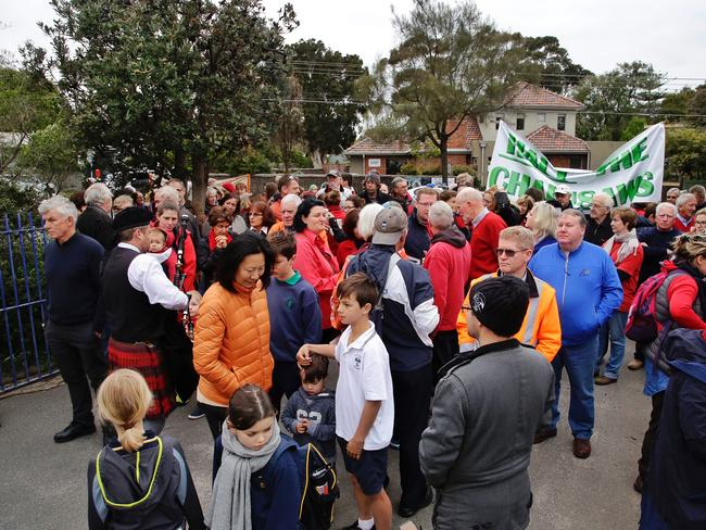 Hundreds protest the planned felling of over 200 trees at the site of the future Beaumaris Secondary College. Picture: Hamish Blair