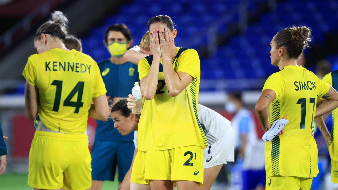 Australian players react after losing a very close fought match to Sweden.