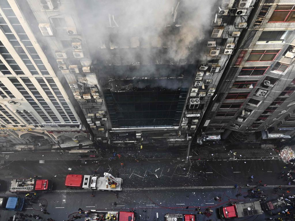 There are fears more people are trapped inside the building. Picture: AFP