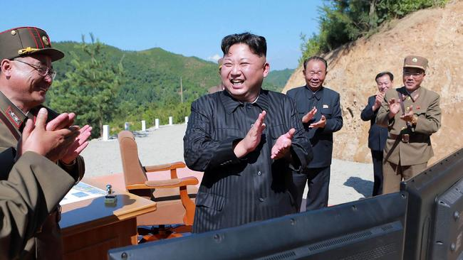 North Korean leader Kim Jong-un celebrates the successful test-fire of the intercontinental ballistic missile Hwasong-14. Picture: AFP/KCNA via KNS/STR