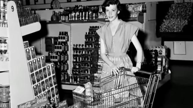 A woman uses an early shopping trolley, the same design still in use today. Picture: Oklahoma Historical Society