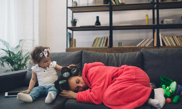 Young mother old is experiencing postnatal depression. Sad and tired woman with PPD. She does not want to play with her daughter.