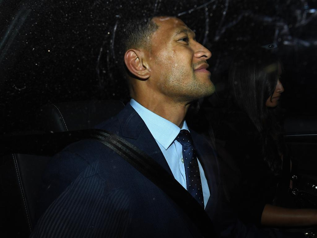 Folau smiles as he leaves a Code of Conduct hearing in Sydney last night. Picture: AAP Image/Joel Carrett