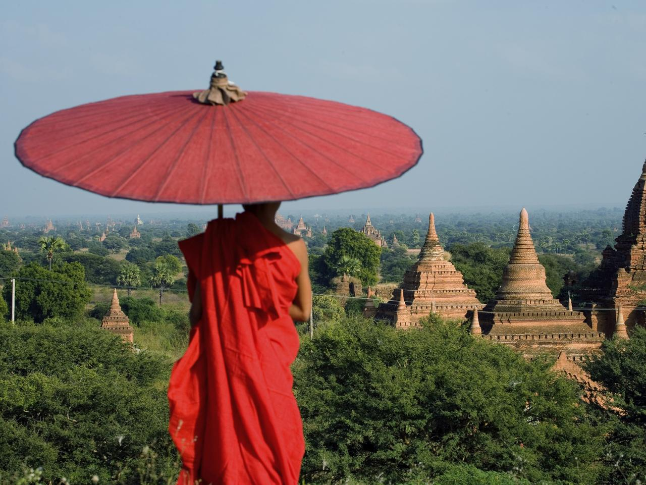 ESCAPE: CONVERSATION STARTER DESTINATIONS .. a novice monk looks over the temples of Bagan in Myanmar. Picture: iStock