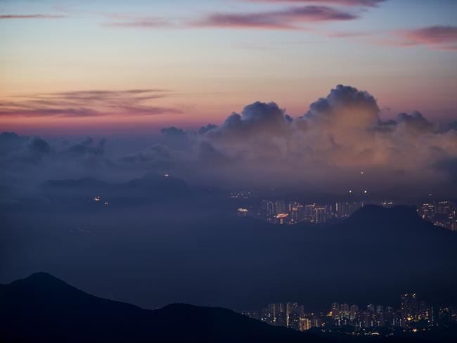 """Just a taxi or MTR ride away (from the city centre), the green rolling hills, quaint beaches and scenic villages quickly replace the bustling urban areas. It's a great day out for couples, friends or families,"" Clark says. Pictured is Tai Mo Shan at twilight by photographer Elvis Mo"