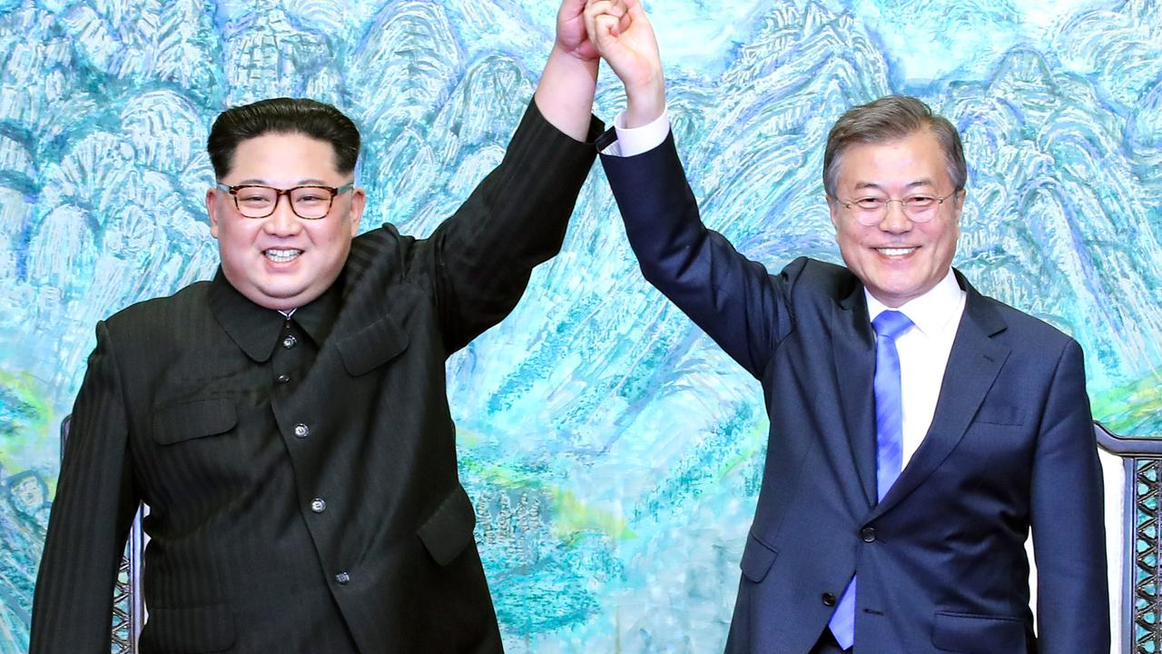 The two Korean leaders in more optimistic times. Picture: Getty Images