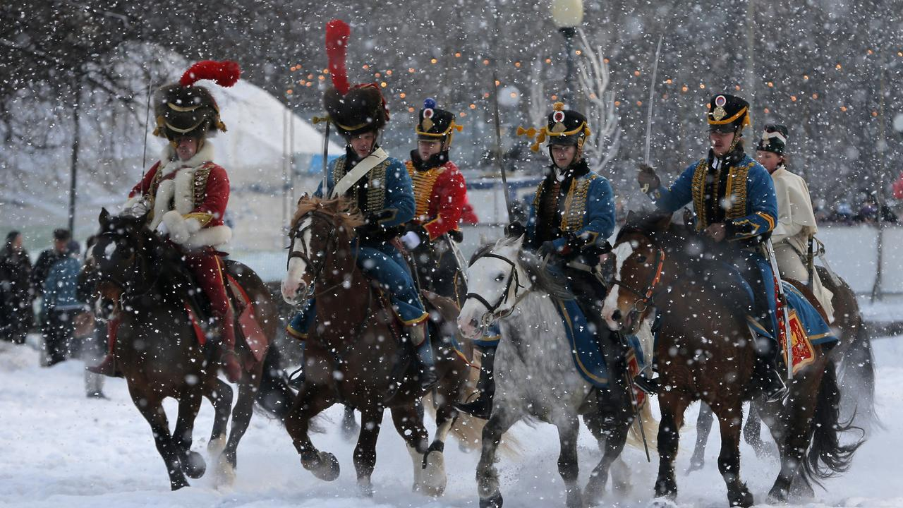 Historical re-enactors dressed as 1812-era French horsemen ride during a reenactment of the French Invasion of Russia in 1812, during celebrations to mark the Russian Orthodox Christmas in St.Petersburg, Russia, Monday, Jan. 7, 2013.  Christmas falls on Jan. 7 for Orthodox Christians who rely on the old Julian calendar rather than the  Gregorian calendar adopted by Catholics and Protestants and commonly used in secular life around the world. (AP Photo/Dmitry Lovetsky) Picture: Ap
