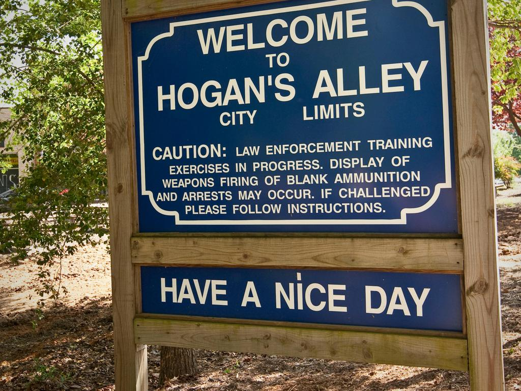 A sign welcoming visitors to Hogan's Alley, tactical training facility at the FBI National Academy in Quantico, VA, USA, 2009. Picture: Alamy