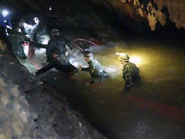 Rescue workers search for the missing boys. Picture: Tham Luang Rescue Operation Center via AP