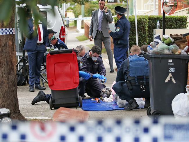 Police collect evidence at the Lakemba address. Picture: Toby Zerna