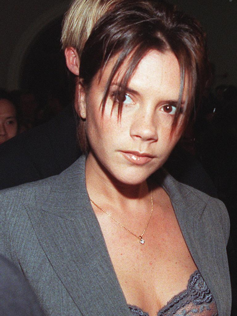 Former Spice Girl Victoria Beckham is pictured at the height of the band's '90s fame.