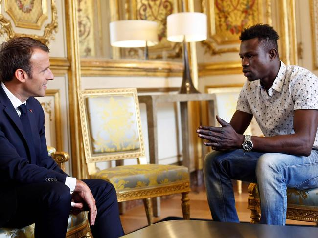 The 22-year-old was praised as a 'hero' by the toddler's family after meeting French President Emmanuel Macron following the daring fifth-floor rescue. Picture: AFP Photo / Pool / Thibault Camus