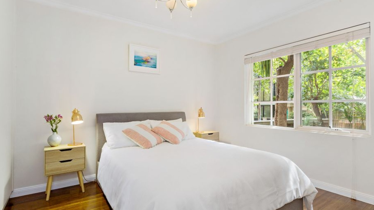 The South Yarra apartment boasts sun-filled bedrooms and bamboo flooring.