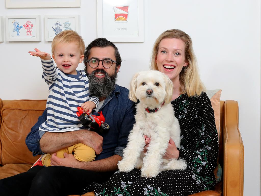 Homeowners Brendan and Clare Willenberg pictured with son Teddy 2 and dog Disco are selling their Marrickville semi now that restrictions around open inspections and on site auctions have eased. Picture: Toby Zerna