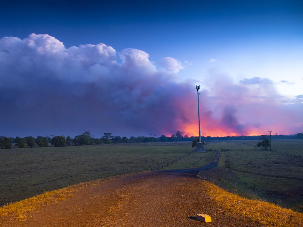Smoke and fire is seen in the distance near Rainbow Flats, NSW, last night. Picture: AAP Image/Shane Chalker