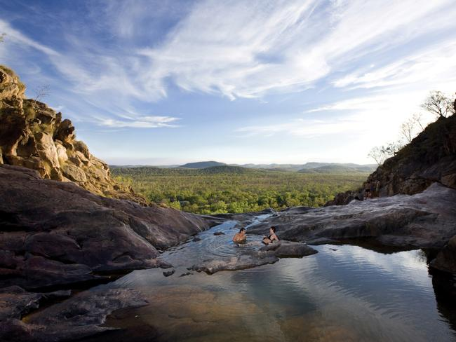2. TAKE A DIP IN AUSTRALIA'S MOST SPECTACULAR NATURAL INFINITY POOL Located on Waterfall Creek, Gunlom – known as Echo Pool where Paul Hogan and Linda Kozlowski take a swim there in Crocodile Dundee – is a magical combination of waterfall and serene plunge pool, with shady gums cooling the picnic areas. The climb to the top of the waterfall is worth the effort as it offers a series of plunge pools, including an infinity rock pool providing panoramic views across the southern parts of Kakadu National Park. The Gunlom Billabong at the base of the waterfall provides a cool, quiet resting place. A walking route to the top of the falls and lookouts takes approximately one hour over a steep terrain and provides sweeping views of the southern most parts of Kakadu National Park. Picture: Kakadu National Park