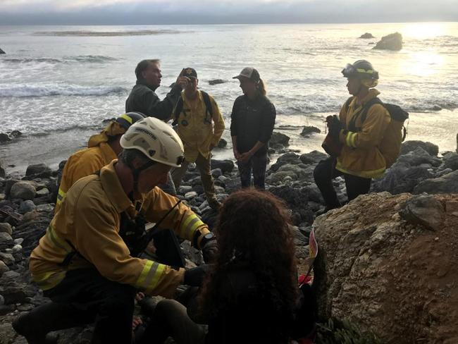 Authorities tend to Angela Hernandez, foreground centre, during the rescue. Picture: Monterey County Sheriff's Office via AP