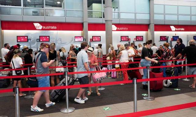 Packed check-in at Virgin Australia at Brisbane Domestic Airport, Brisbane, 21st of December 2020. (News Corp/Attila Csaszar)