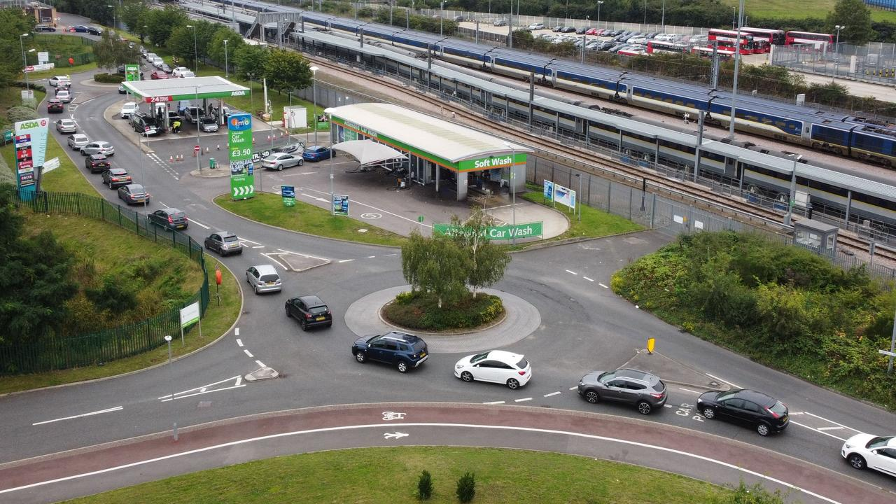 A huge queue of cars wait at a London service station, in a scene being repeated right across the UK. Picture: AFP