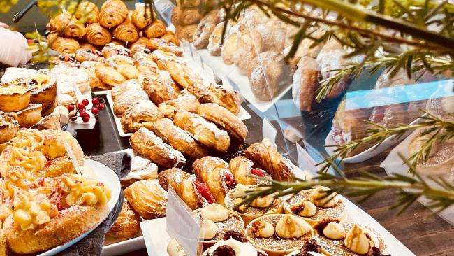 3/20Clementine BakeryYass Yass's favourite eatery transformed itself into the fragrant   Clementine Bakery when it met with Covid-19 and there's been no looking back. Excellent bread, buttery cakes and a range of danish line the counters. Inside the warming cabinet are some of the nation's best pies - luxuriously plump fillings including Steak Dianne or Chicken leek and bacon are encased in crisp, golden pastry.  Sausage rolls, resplendent with porky goodness are the ultimate pig in a blanket. Picture: Instagram/@clementinebakeryyass