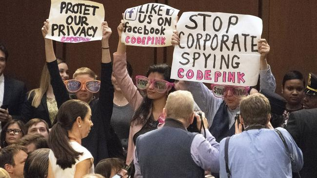 Protesters during Mark Zuckerberg's hearing. Picture: Ron Sachs