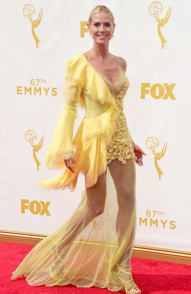 """""""I tore up three different canary yellow dresses to make one!"""" Picture: Getty Images."""