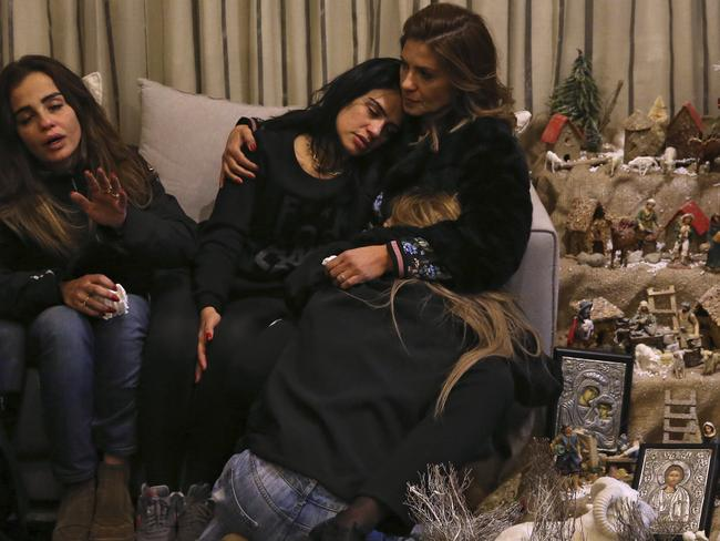 Sisters of Elias Wardini, a Lebanese man who was killed in the overnight Istanbul attack, mourn at their house in Beirut, Lebanon. Picture: AP