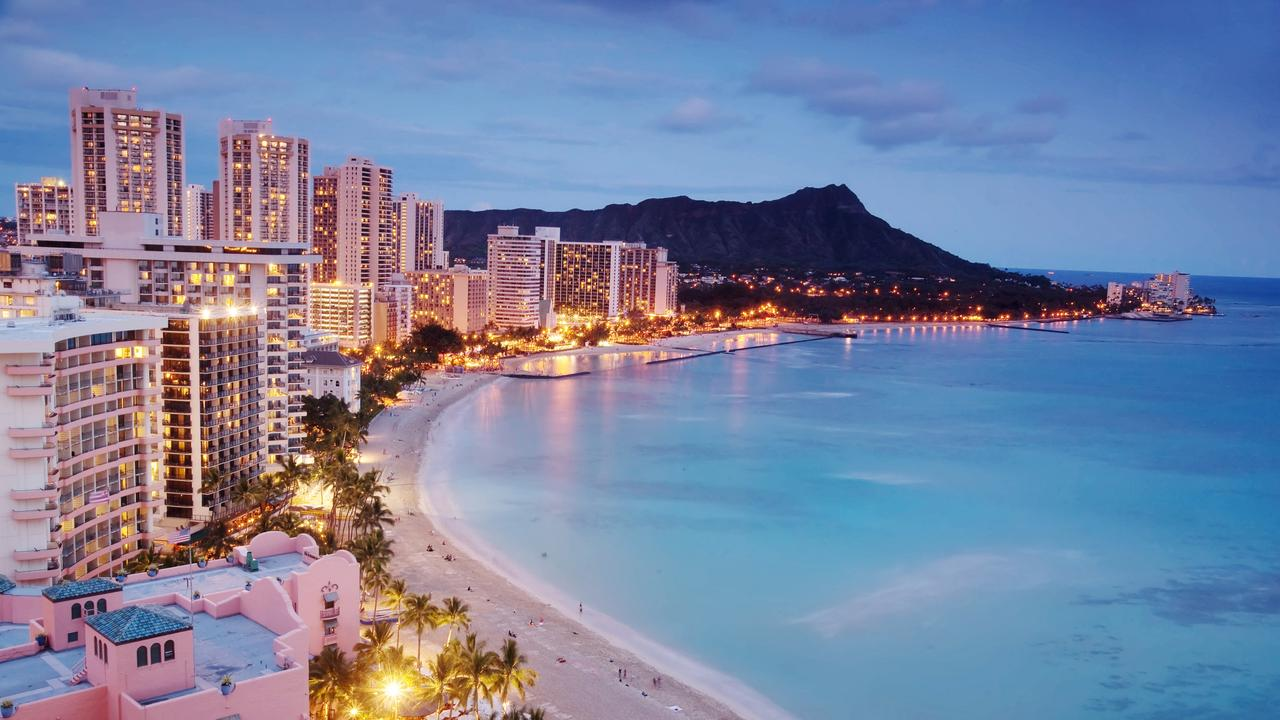 The quintessential view of Waikiki, Hawaii — luxury hotels, the beach, and Diamond Head.