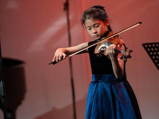 Tracy Zhao performing violin on stage. Picture: supplied