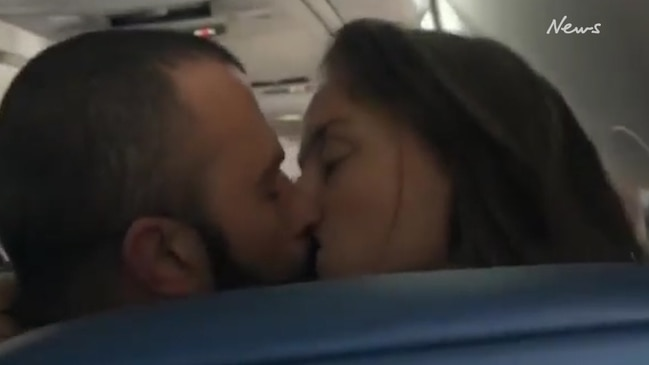 Passenger slammed for 'creepy' video of couple kissing mid-flight