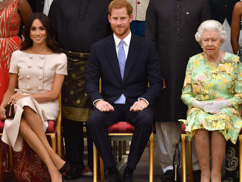 Meghan, Duchess of Sussex, Prince Harry, and Queen Elizabeth II.