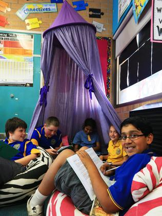 Sanjay-Aryan Mair (front) sits on a bean bag while other students enjoy the tent. Picture: Toby Zerna