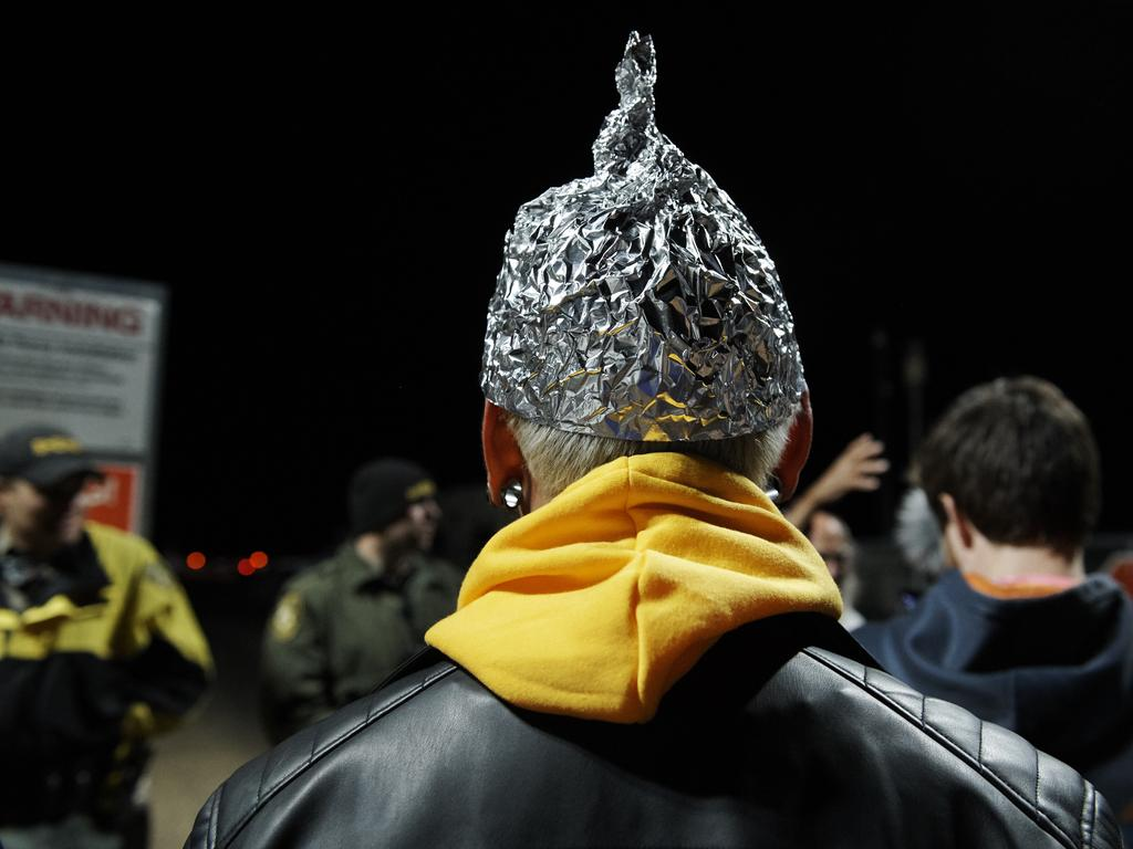 Attendee Daniel Rodriguez wears at tinfoil hat as he waited to 'storm' Area 51. Picture: Bridget BENNETT / AFP