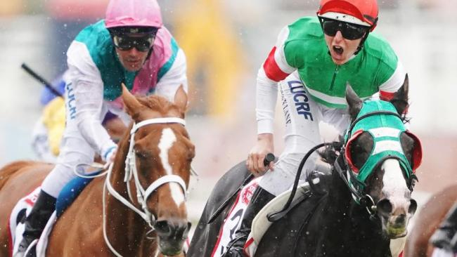 Lane roars his approval as Japan's Mer De Glace come from the clouds to claim the $5 million Caulfield Cup.