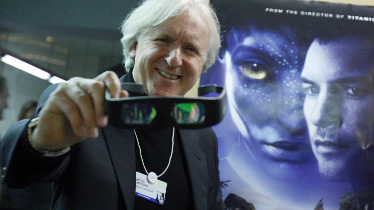 Director James Cameron with the 3D glasses people would wear while watching Avatar.